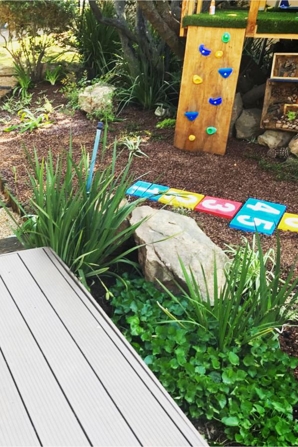 Backyard herb garden to attract hummingbirds and kids! #gardenideas #backyardideas